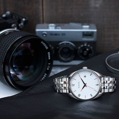 Nixon. Welcome #thebullet. Nixon silver and white watch - camera