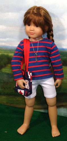 This outfit has been Reserved…Thanks! This casual outfit, perfect for Memorial Day or the Fourth of July, consists of white stretch denim shorts, a navy and red stripped knit shirt, a necklace with a key, and a patriotic themed tote with red straps and a button and bow and the side.