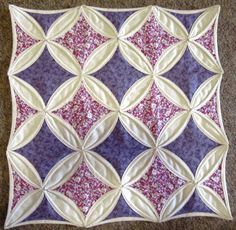 Tried the sewing machine cathedral window. Going to have to perfect it a little more before making a whole quilt.