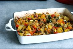 Baked Vegetables    2 potatoes, peeled and cubed    4 carrots, cut into 1 inch pieces    1 head fresh broccoli, cut into florets    4 zucchini, thickly sliced    + onions, red peppers,     salt to taste    1/4 cup olive oil    1 (1 ounce) package dry onion soup mix