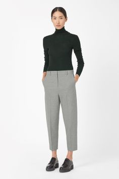 A relaxed shape with softly rounded proportions, these cropped trousers are made from wool-mix with a subtle melange quality. Designed to sit between the hips and waist, they have a dropped crotched, slanted pockets and a classic zip-fly fastening. Cos Trousers, Cropped Trousers, Trousers Women, Pants For Women, Trousers Fashion, Curvy Women Fashion, Womens Fashion For Work, Fashion Designer, Dressing