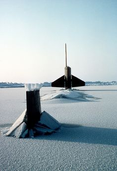 Submarine surfaces through ice