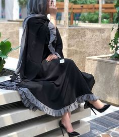 Black and grey combination umbrella nida abaya with ruffles Iranian Women Fashion, Islamic Fashion, Muslim Fashion, Muslim Girls, Muslim Women, Niqab Fashion, Fashion Outfits, Hijab Style Dress, Kimono Outfit
