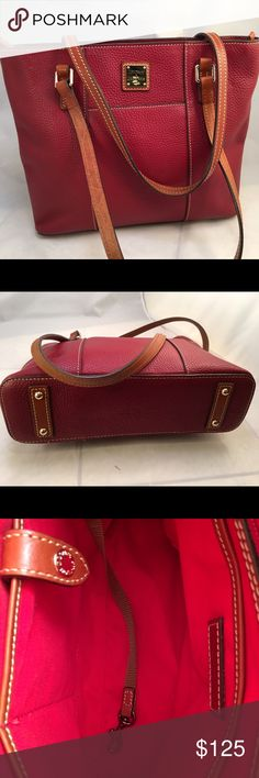 Dooney and Bourke small Lexington Bag Dooney and Bourke Lexington pebble grain bag. Color is wine. Perfect for incoming Christmas. Measurement 12 X 10.5 x3.5 inches. Excellent condition. Dooney & Bourke Bags Totes