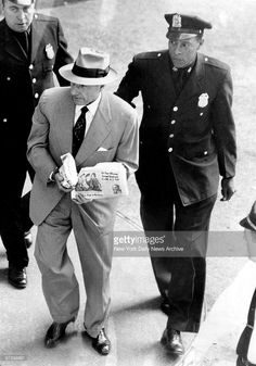 Frank Costello, carrying parcels over manacled hands, is hustled from City Prison. Real Gangster, Mafia Gangster, Italian Mobsters, Frank Costello, Mafia Crime, Celebrities Then And Now, Al Capone, Tough Guy, Thug Life