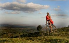 A Maasai is riding his bike over the Ngong Hills. (Kenya) (Chris Minihane)