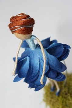 Wire, silk flowers, and embroidery thread doll!
