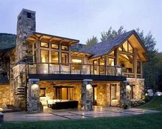 Love the look of this house with the stone and wood.