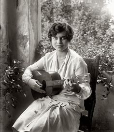 The Washington, D.C., socialite, later Mrs. Victor Alfaro, in September 1926. She's playing a Regal tenor guitar.