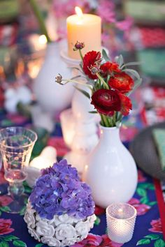 White vases with bright, colorful flowers gives a vintage feel to your centerpieces