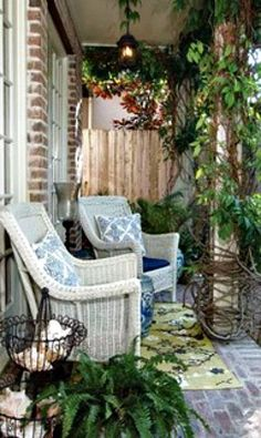 Love the cozy feeling of this porch!