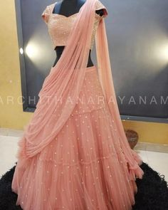 Life is as peachy as I make it to be.Signature Studded blouse with a tiered lehenga!Stunning blush pink color lehenga and blouse with net dupatta. Lehenga and blouse with hand embroidery kundan work. Lehenga Choli Wedding, Half Saree Lehenga, Designer Bridal Lehenga, Party Wear Lehenga, Party Wear Dresses, Lehenga Blouse, Indian Bridal Outfits, Indian Designer Outfits, Outfit Designer
