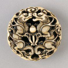 Ryuko (Japan)   Confronting Dragons, mid-19th century  Netsuke, Ivory with staining, sumi; ryusa type. LACMA