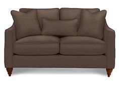 """Channel your inner designer with the Delany loveseat's on-trend style. With shapely track arms, beautiful welt detailing and delicately turned legs, it's a look that can't help but get noticed. Spice things up with unexpected details including contrasting welt and accent pillows and create a look all your own! Comes standard with two 18"""" accent pil-lows and one 12x23 kidney pillow. Available in a wide variety of fabrics and leathers. See the complete Delaney collection for additional…"""