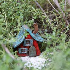This wee Fairy Home--a soft blue with teal shutters, a bright red door and turquoise shingles--was completely hand-sculpted using a dark brown clay Clay Houses, Ceramic Houses, Gnome House, Fairy Houses, Leprechaun, Northern California, Pixie, Ceramics, Shutters