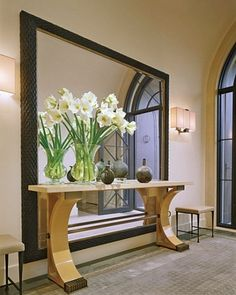 Bella Maison Interior design: Wall Size mirror for maximum drama.