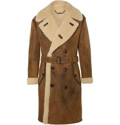 This Ralph Lauren Purple Label 'Arbury' coat is an investment in ageless style. Masterfully crafted in Italy from plush brown shearling and detailed with leather trims, it will keep you exceptionally warm right down to the knee. Wear it with the removable belt if you're after a more defined profile.