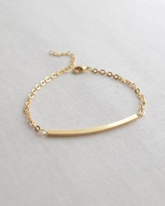 Gold Curved Bar Bracelet by Olive Yew. Chic curved bar bracelet - so stylish. Bracelet is adjustable from 7 to 8 inches. Also available in silver.