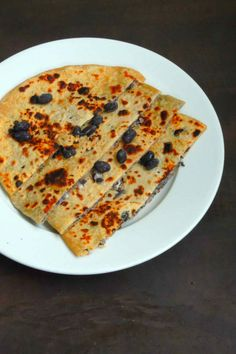 Heres a protein-rich black beans stuffed paratha This is a healthy meal that you can serve either for lunch or dinner with raita of your choice and spicy pickle or curry. Recipe by Priya.   --> http://ift.tt/1VPpcIt #Vegetarian #Recipes