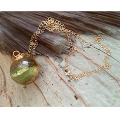 Wattle filled resin orb pendant necklace with hand made gold spiral bead cap, gold chain. Perfect for Valentine's Day.