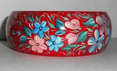 Beautiful wooden bracelets handmade with pink and blue flowers in unique traditional russian art folk style in shop on Etsy
