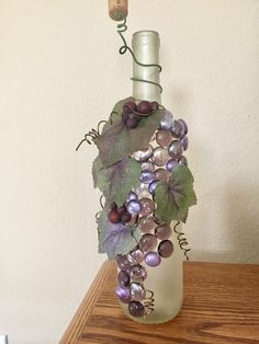 Frosted wine bottle with green beads