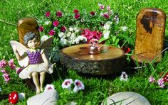 A miniature fairy enjoys a spot of tea in our flower filled fairy garden.
