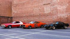 """1974-76 Ford Gran Torino (with custom """"vector"""" stripe, from Starsky & Hutch), 1968-70 Dodge Charger (The General Lee from The Dukes of Hazzard), and 1976-77 Pontiac Trans Am (from Smokey and the Bandit)"""