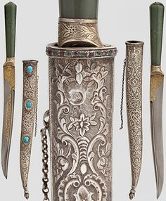 Ottoman dagger with a yatagan shaped Damascus blade fullered at the back on both sides, the base with floral gold inlays and calligraphic cartouche on the obverse. Silver grip ferrule, conical jade grip, the pommel with silver-set diamonds and a ruby at centrer, silver scabbard beautifully embossed with a floral design, a tughra stamp on the reverse (Mahmud II?). The locket decorated with set rubies, diamonds, turquoises and topazes around the perimeter and on the viewing side, 19th century.