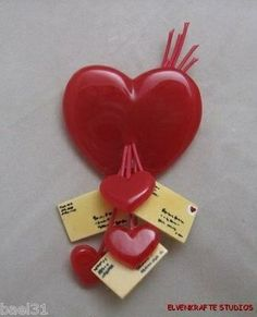 1940's Bakelite heart and love letters pin.