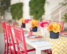 Hot pink chairs, yellow chevron runner, blue jean vases