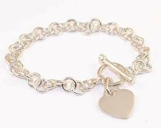 "8"" Tiffany Style Sterling Silver Small Round Link Heart Charm Toggle Bracelet / 20.7 Grams A2 Silverinvasion Jewelry. $64.95. Heart Charm Size: 3/4"" x 3/4"" ( 18 x 18 mm ). Small Round Link Heart Charm Bracelet 8"". Genuine .925 Sterling Silver. Link: 7 mm round. Weight: 20.7 grams"