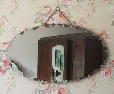wallpaper + old mirror...old-fashioned charm