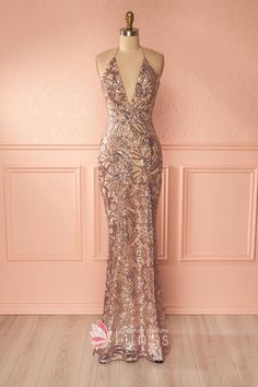 Dazzling gold sequin fitted mermaid long evening prom dress. Plunging V-neckline. Halter spaghetti straps.