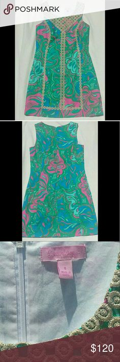 "Lilly Pultzer MacFarlane Shift Dress EUC Multi Lilly Lounge Size 8, 100% cotton, machine wash, sleeveless sheath dress in abstract print featuring gold medallion lace overlay at bodice and seams hidden back zipper. Lay flat measurement  Length from sholder to hem: 34"" Armpit to Armpit:17.5"" Lilly Pulitzer Dresses Midi"