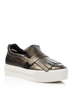 Ash King Metallic Snake-Embossed Slip On Platform Sneakers $235.00 A fashion-forward hybrid of a sporty slip-on and kiltie loafer, Ash's metallic platform sneakers add undeniably cool lift to any look.