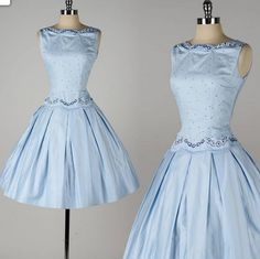 1950s summer dress of blue polished cotton with embroidered daisy detail. Beautifully styled with swagged neckline and fitted dropped waist.