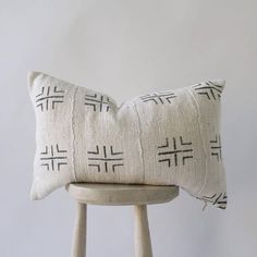 Authentic African Mudcloth decorative pillow handmade in Africa. The back is made of natural canvas with gold zipper enclosure. Variations may be available. Fabric and pillow made by hand, so each will differ slightly. Pillow fill only included for bed pillow style -- lumbar fills offered
