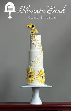 Sunflower Wedding Cake by Shannon Bond Cake Design in Kansas City  Buttercream Bas relief piped sunflowers and yellow brick road for a tribute to a Kansas wedding. Topped with gumpaste sugar flowers. There's no place like home!