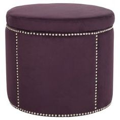 """Storage ottoman with nailhead accents.   Product: Storage ottomanConstruction Material: Plywood and polyesterColor: WineFeatures:  Nailhead accentsRemovable top with hidden storage Dimensions: 18.9"""" H x 22"""" Diameter"""