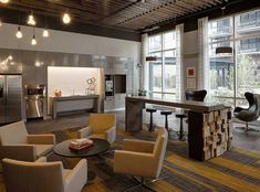 Kitchen lounge with coffee bar at AMLI Lofts, luxury South Loop apartments in Chicago.