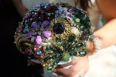 DIY brooch bouquet for a peacock wedding