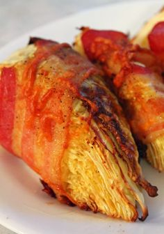 Jo and Sue: Bacon Wrapped Cabbage. Only takes a minute to prepare and comes in at under 100 calories per wedge.