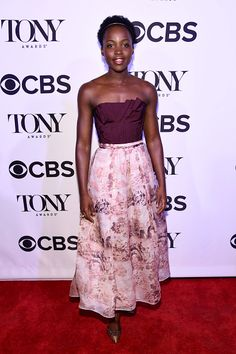 Lupita Nyong'o attends the Tony Honors Cocktail Party wearing Oscar de la Renta Fall 2016 RTW