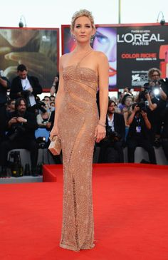 For the 2012 Venice Film Festival, Kate wowed in a blush beaded and fringe-detail Atelier Versace gown.