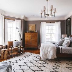 A Moroccan style shag rug from west elm is the anchor to this cozy bedroom.