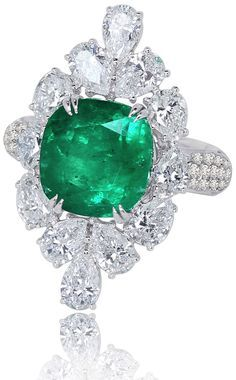 Ring from Columbian Emerald collection by Sutra Jewels in 18K white gold set with a 8 carats Emerald Pear-Cut and Brilliant-Cut Diamonds.