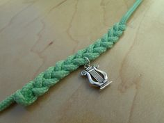 AXOB1- Braided Rope Charm Bracelet. $12.50, via Etsy.