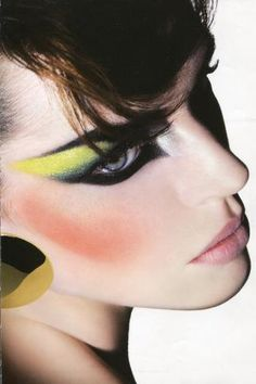 Overstated make-up. Lots of blush, black eyeliner and bright-coloured eye shadow.
