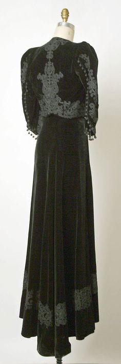 Evening ensemble Attributed to Elsa Schiaparelli  (Italian, 1890–1973)  Department Store: Made by Bonwit Teller & Co. (American, founded 1907) Date: 1936–38 Culture: French Medium: (a,b) silk, cotton (c) silk, cotton, metal (d) metal, glass. Back
